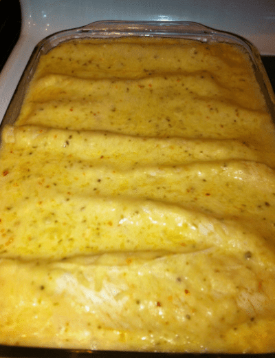 casserole dish with chicken enchiladas