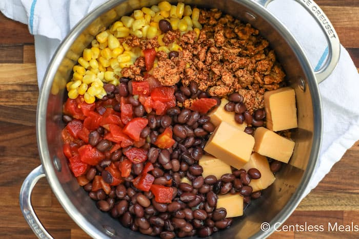 Mexican cheese soup ingredients in a pot