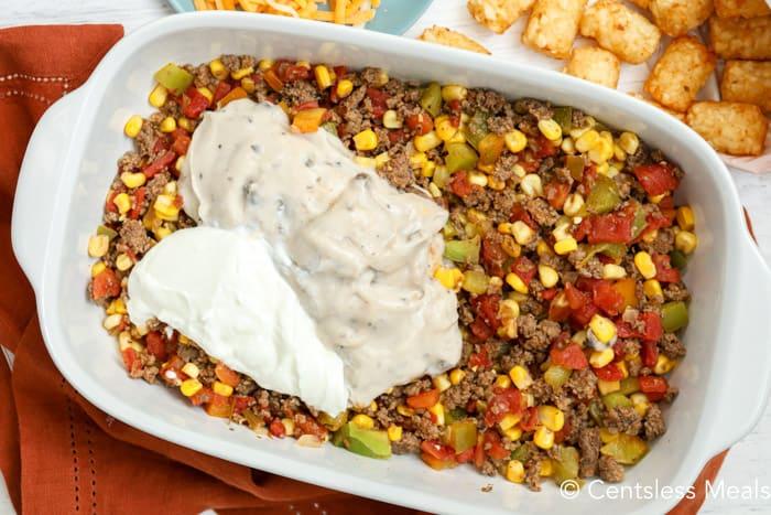 Cowboy casserole ingredients in a casserole dish