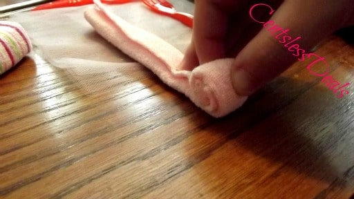 washcloth being rolled up by a hand