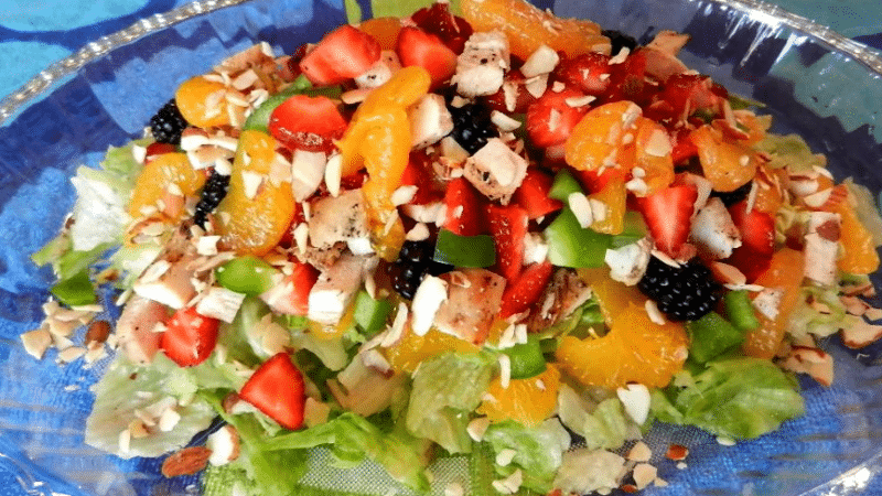 light and fruity chicken salad in a clear bowl