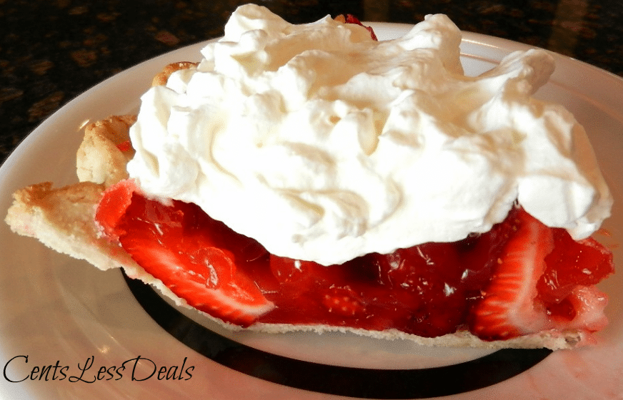 Merry Strawberry pie on a plate with whipped cream