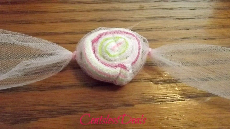 Washcloth candy wrapped in mesh on a table top