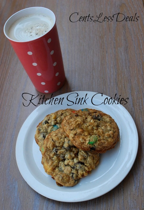 kitchen sink cookies on a white plate with hot chocolate