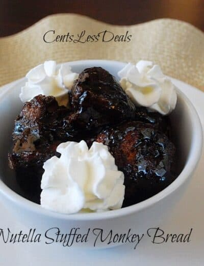 nutella stuffed monkey bread in a bowl with whipped cream