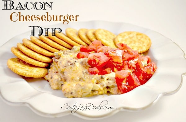bacon cheeseburger dip with tomato garnish, with crackers, on a tan plate