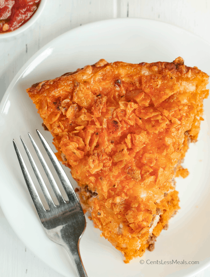 This easy Dorito Pie is one recipe everyone will agree on! Layers of seasoned beef, sour cream and Doritos all nestled in a crescent roll crust and baked until hot and bubbly.