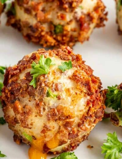 Mashed potato ball on a plate with parsley on top
