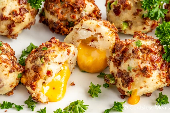 Mashed potato balls on a plate with parsley
