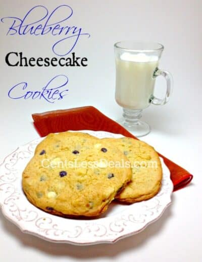 blueberry cheesecake cookies on a plate with a glass of milk and a title
