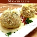chicken parmesan meatballs on a serving plate with parsley and a title