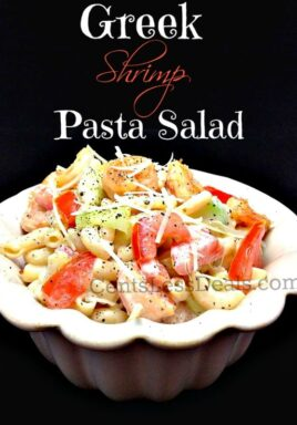greek shrimp pasta salad in a white bowl with a title