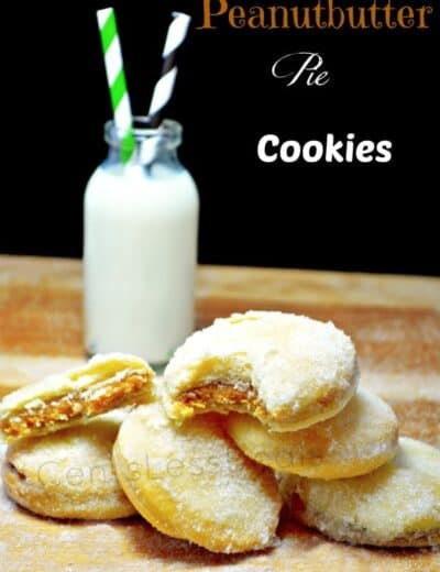 peanut butter pie cookies on a wooden board with milk in the background and a title