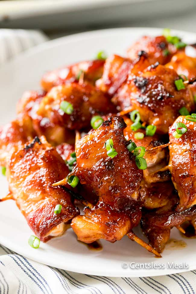 This Bacon Wrapped Chicken Bites recipe brings together two of my favorite food combinations, crisp bacon and tender juicy chicken! Smothered in a sweet bbq sauce and browned to perfection, this appetizer is mouth watering delicious!