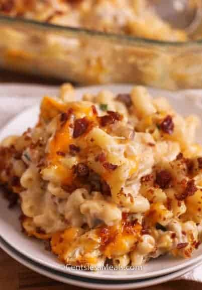 Bacon chicken macaroni and cheese on a white plate