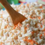 Classic macaroni salad in a bowl with a wooden spoon