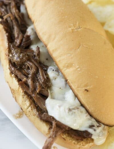 Crock-Pot Italian beef sandwich on a white plate