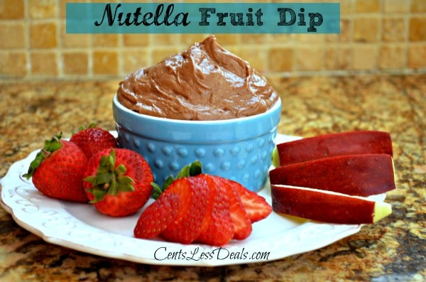 Nutella fruit dip in a blue bowl with fruit on a white plate and a title