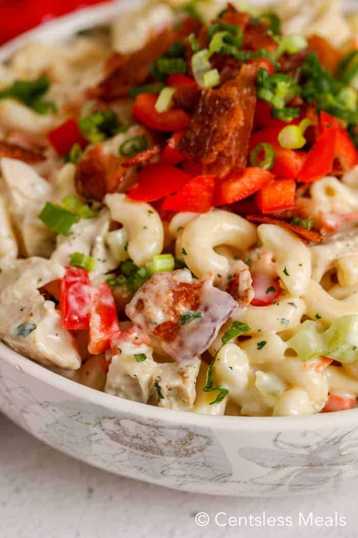 Ranch macaroni salad with bacon and chicken in a bowl