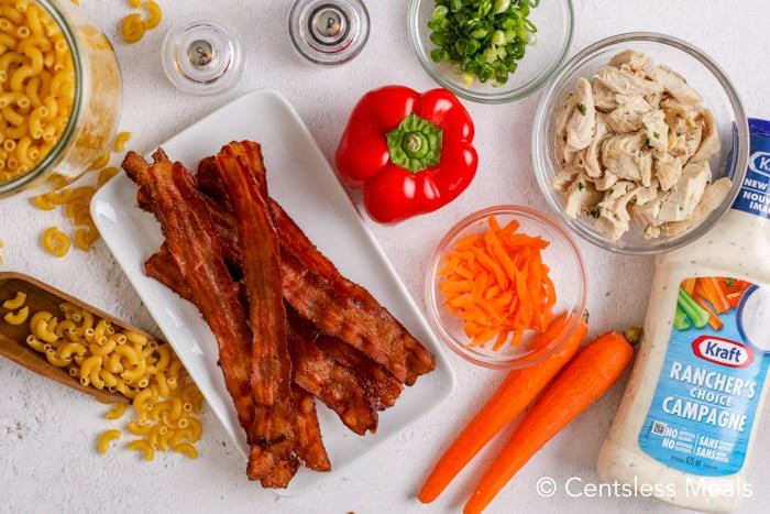 Ingredients to make ranch macaroni salad with bacon and chicken.