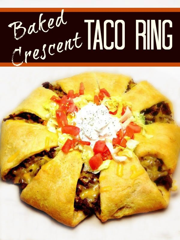 This Baked Taco Ring is super easy and puts a fun twist on tacos! Seasoned ground beef and cheese are encased by a crescent dough crust, then topped with lettuce, onion, tomato and sour cream. It will definitely become a family favorite.