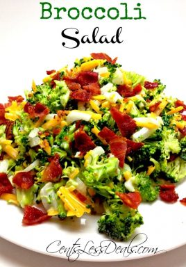 Broccoli salad on a white plate with writing