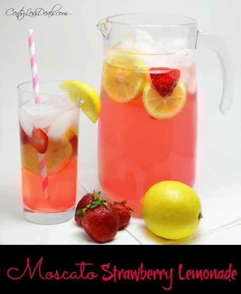 Moscato strawberry lemonade in a glass and in a glass pitcher with strawberries and lemon on the side