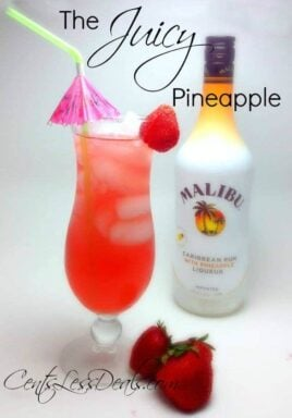 The juicy pineapple drink recipe in a glass with Malibu and strawberries