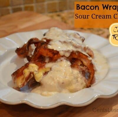 Bacon wrapped sour cream chicken Crock-Pot recipe on a plate with writing