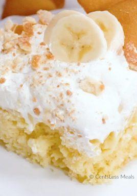Banana Pudding poke cake with whipped cream and bananas