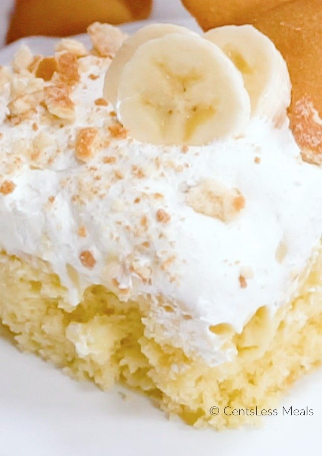 This Banana Pudding Poke Cake is the perfect potluck dish! A soft fluffy yellow cake topped with creamy banana pudding, whipped topping and 'Nilla wafers! This is one recipe you'll make over and over!