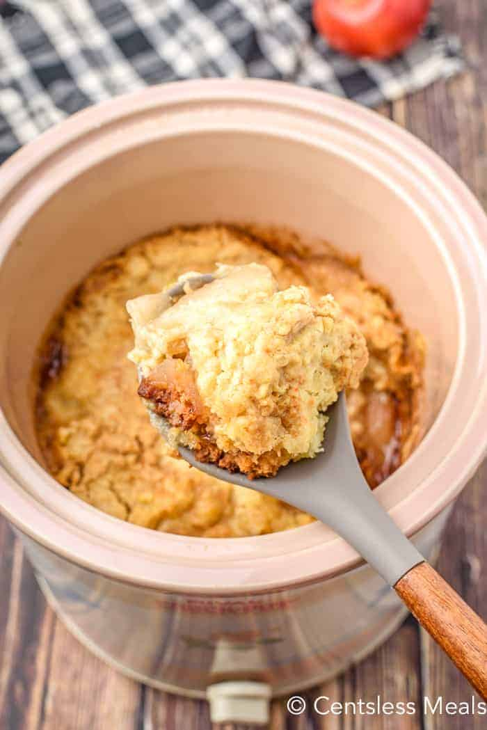 Apple Cobbler being scooped our of the crock pot
