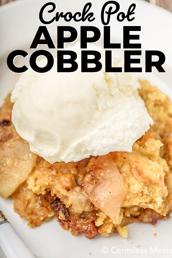 Crock Pot Apple Cobbler served on a white plate with a scoop of ice cream on top.