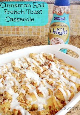 Cinnamon roll french toast casserole in a white dish with International Delight in the background with a title
