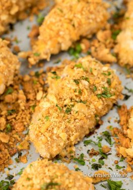 Ritz cracker chicken on a sheet pan with parsley