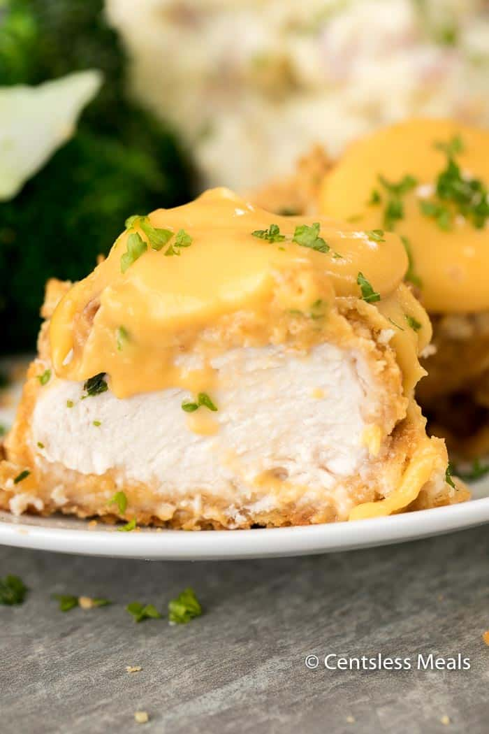 The only thing better than a chicken breast is this Ritz Cracker Chicken with a cheesy crispy coating and an easy homemade cheese sauce.