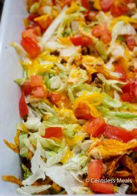 Taco casserole in a white casserole dish
