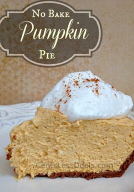Cream cheese pumpkin pie on a white plate with whipped cream and writing