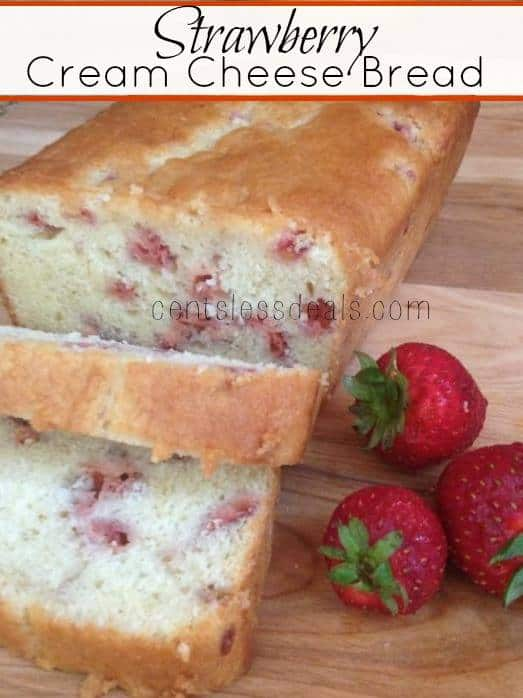 Strawberry cream cheese bread on a wooden board with strawberries and a title