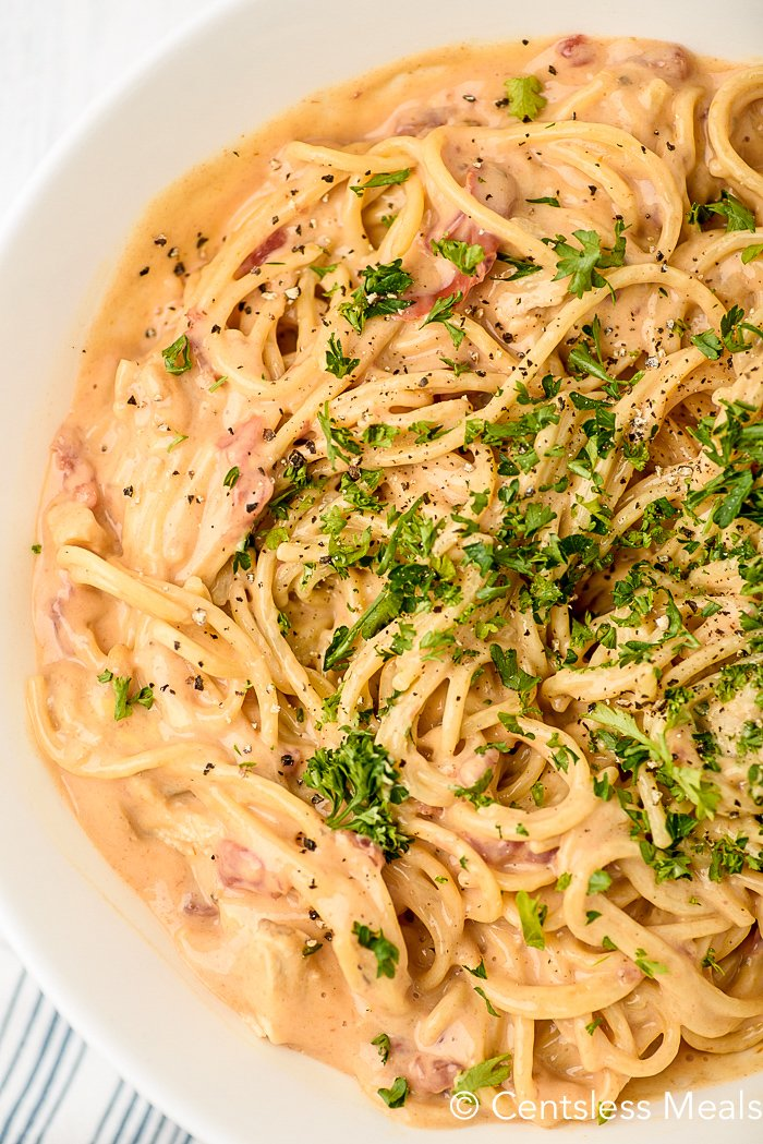 Overview of chicken spaghetti garnished with parsley.