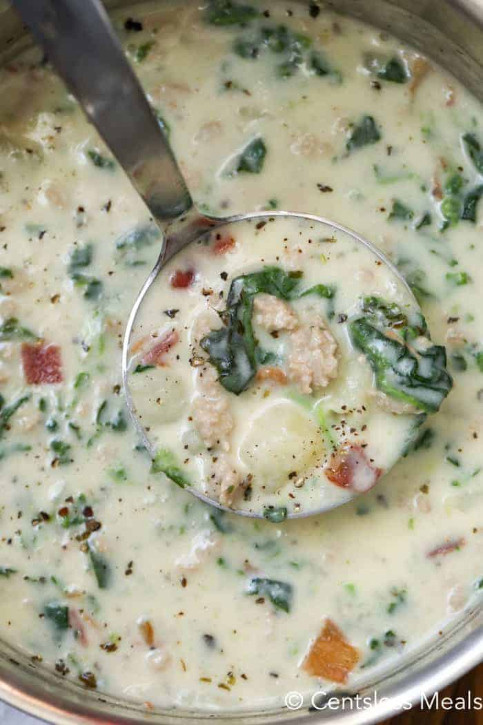 Zuppa Toscana in a pot with a ladle