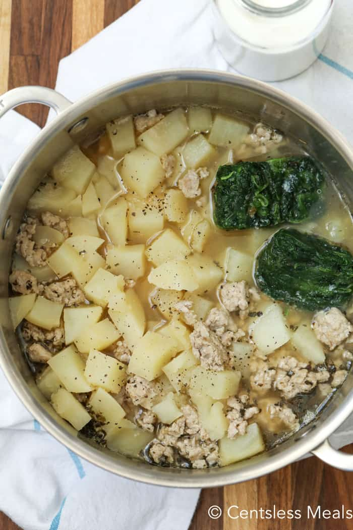 Zuppa Toscana ingredients in a pot