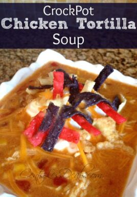 Crock-Pot chicken tortilla soup in a white bowl with sour cream and tortilla chips with a title