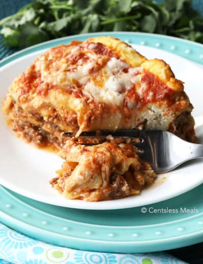 Cheesy Crock-Pot lasagna on a plate with a fork