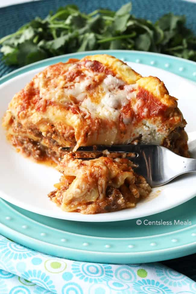 A slice of Crock Pot Lasagna on a plate.