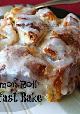 Piece of cinnamon roll on a plate with a fork and a title