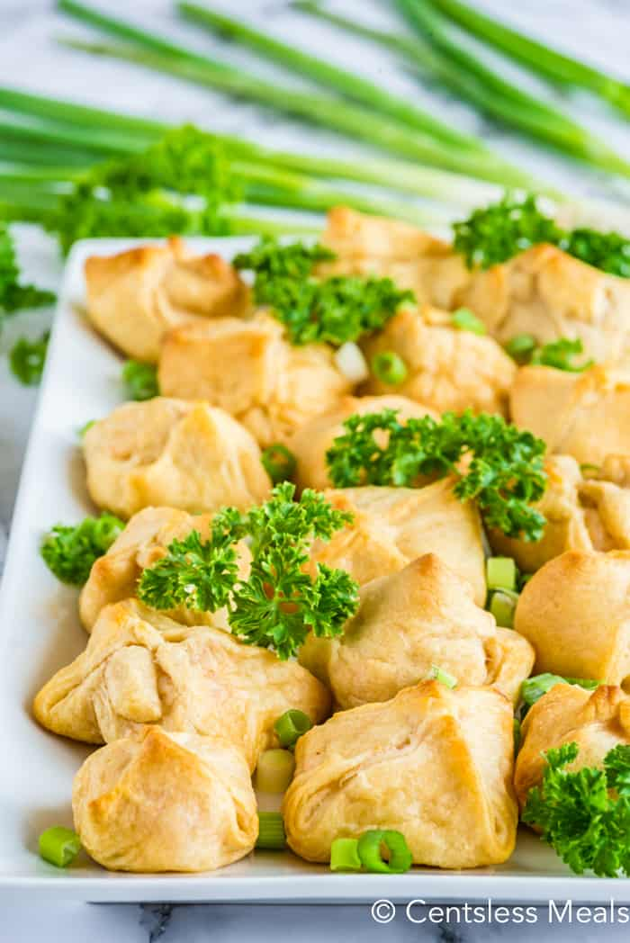Crab filled crescents cooked and assembled on a white platter