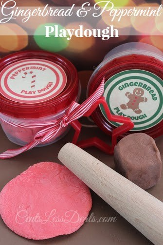 Containers of Gingerbread and Peppermint Playdough with ribbons and cute labels, with a cookie cutter attached, with play dough on the counter with a rolling pin
