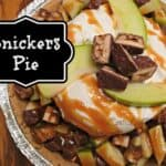 Snickers pie ingredients in a pie plate with a title