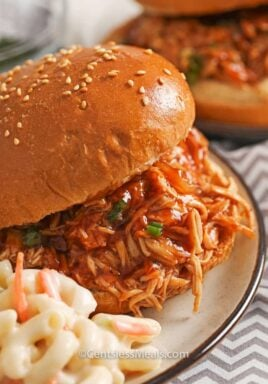 Crock-Pot BBQ beer chicken sandwiches on a plate with macaroni salad